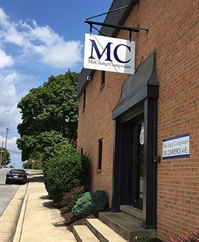 McClung front door and sign as seen from sidewalk.