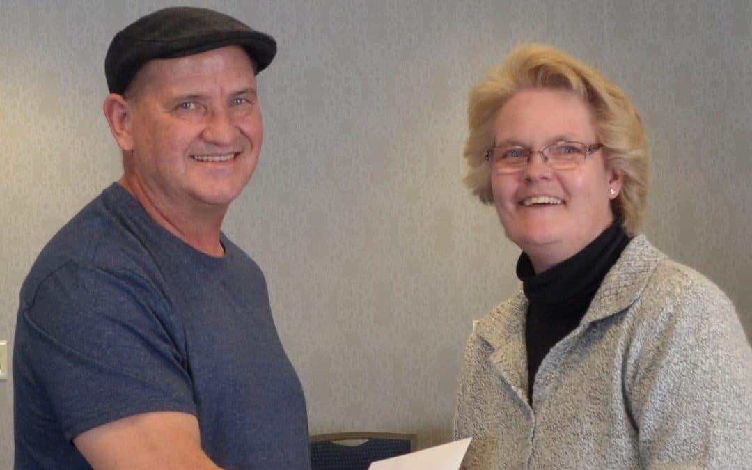 Sheila hands Carl award
