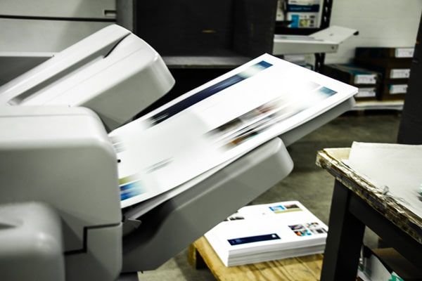 A photo copier in the process of printing a copy.