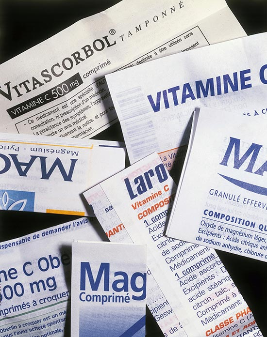 Stack of several folded pharmaceutical Instruction-for-Use print-outs